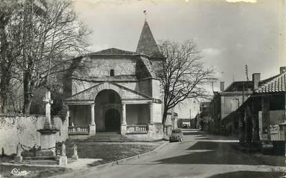 """/ CPSM FRANCE 24 """"Mensignac, l'église et la rue principale"""""""