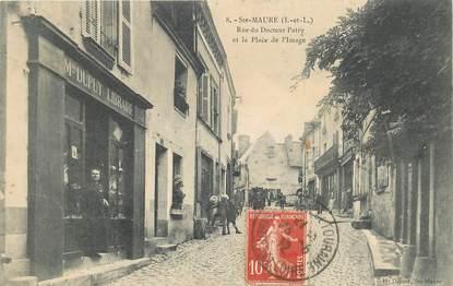 """CPA FRANCE 37 """"Sainte Maure, rue du Docteur Patry et la place de l'Image, Librairie Mme DUPUY"""""""