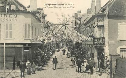 """CPA FRANCE 77 """"Bray sur Seine, la grande rue, un jour de fête"""""""