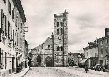 """/ CPSM FRANCE 03 """"Gannat, l'église Sainte Croix et la place"""""""