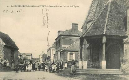 """CPA FRANCE 27 """"La Madeleine de Nonancourt, grande rue et porche de l'Eglise"""""""
