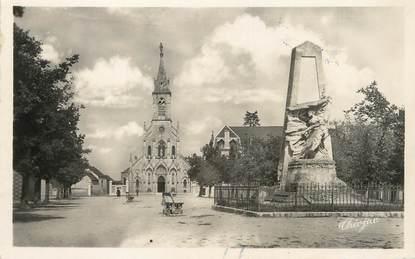 """/ CPSM FRANCE 36 """"Issoudun, basilique Notre Dame du Sacré Coeur et monument de 1870"""""""