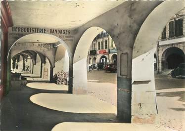 """/ CPSM FRANCE 39 """"Lons Le Saunier, rue du commerce, les arcades"""""""