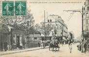 """95 Val D'oise / CPA FRANCE 95 """"Enghien les Bains, la grande rue au pont du chemin de fer"""""""