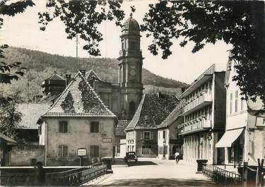 """/ CPSM FRANCE 68 """"Guebwiller, rue de la gare, église Notre Dame"""""""