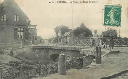 """/ CPA FRANCE 59 """"Douchy, le pont et la route de Cambrai"""""""