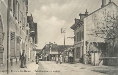 """/ CPA FRANCE 01 """"Divonne Les Bains, rue principale et postes"""""""