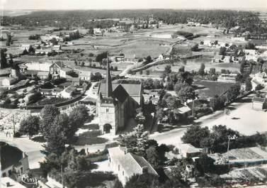"""/ CPSM FRANCE 85 """"Notre Dame de Monts, vue aérienne, l'église"""""""