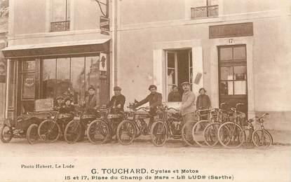 """CPA FRANCE 72 """"Le Lude, Cycles et Motos G.Touchard, Place du Champ de Mars"""""""