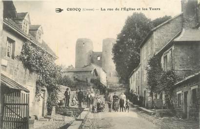"""/ CPA FRANCE 23 """"Crocq, la rue de l'église et les tours"""""""