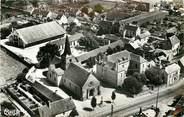 """58 Nievre CPSM FRANCE 58 """"Dornes, vue aérienne sur les Ecoles, l'Eglise et le Marché"""""""