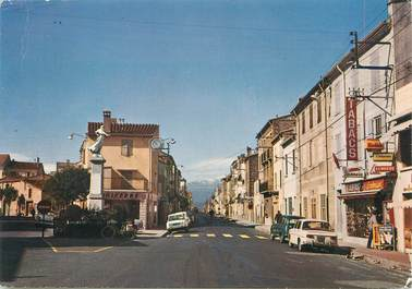 """/ CPSM FRANCE 66 """"Le Boulou, l'entrée de la ville et le monument aux morts"""""""