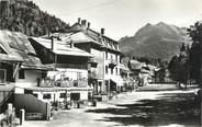 """74 Haute Savoie .CPSM  FRANCE 74 """"Abondance, Rue principale et Mont Entre Deux Pertuis"""""""