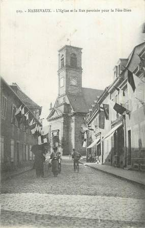 """CPA FRANCE 68 """"Massevaux, L'église et a rue pavoisée pour la fête dieu""""."""