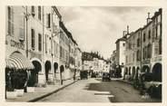 """88 Vosge CPSM FRANCE 91 """" Remiremont, Grande rue et les arcades""""."""