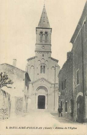 """CPA FRANCE 30 """" St Hilaire d'Ozilhan, Avenue de l'église""""."""