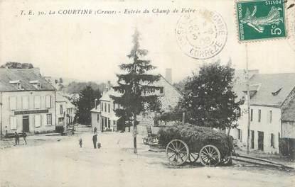 """CPA FRANCE 23 """"La Courtine, Entrée du champ de foire""""."""