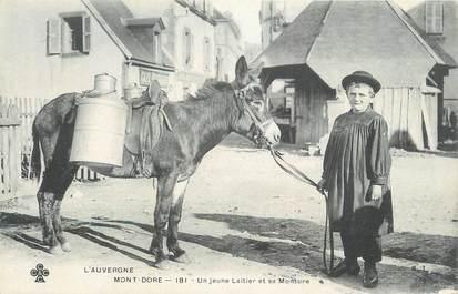 """CPA FRANCE 63 """" Le Mont Doré, Un jeune laitier et sa monture"""". / ANE / LAITIER"""