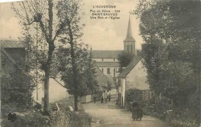 """CPA FRANCE 63 """" St Sauves, Une rue et l'église""""."""
