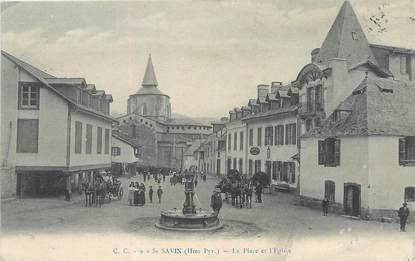 """CPA FRANCE 65 """" St Savin, La place et l'église""""."""
