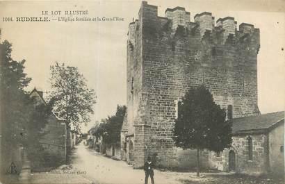 """CPA FRANCE 46 """"Rudelle, L'église fortifiée et la grande rue""""."""
