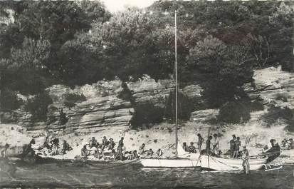 """CPSM FRANCE 83 """" Ile du Levant, La plage des grottes, les naturistes""""."""