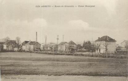 """CPA FRANCE 38 """"Les Abrets, Route de Grenoble, Usine Bourgeat""""."""