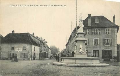 "CPA FRANCE 38 ""Les Abrets, La fontaine et rue Gambetta""."