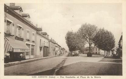 """CPA FRANCE 38 """"Les Abrets, Rue Gambetta et Place de la Mairie""""."""
