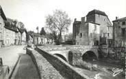 """16 Charente CPSM FRANCE 16 """" Confolens, Le vieux manoir et le Pont sur la Goire""""."""