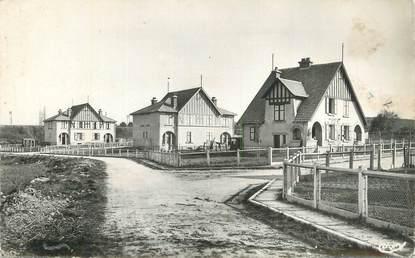 """CPSM FRANCE 16 """"La Couronne, Usine à ciment Laffarge et du Theil, cité ouvrière""""."""