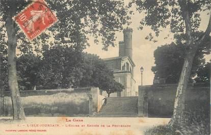 """CPA FRANCE 32 """" L'Isle Jourdain, L'église et entrée de la promenade""""."""