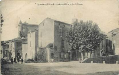"""CPA FRANCE 34 """"Laurens, Grande rue et le château""""."""