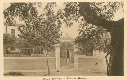 """CPA FRANCE 34 """"Caux, Ecoles des garçons""""."""
