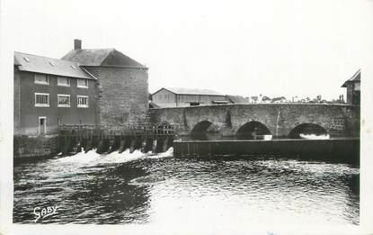 """CPSM FRANCE 50 """" Ducey, Le moulin et le vieux pont sur la Sélune""""."""