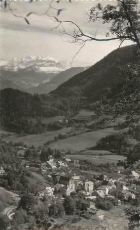 """CPSM FRANCE 74 """" St Jeoire en Faucigny, La ville et le Mont Blanc'."""