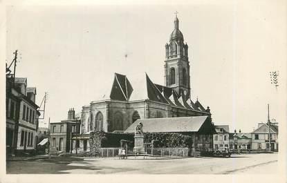 """CPSM FRANCE 76 """"Buchy, L'église et le monument aux morts""""."""