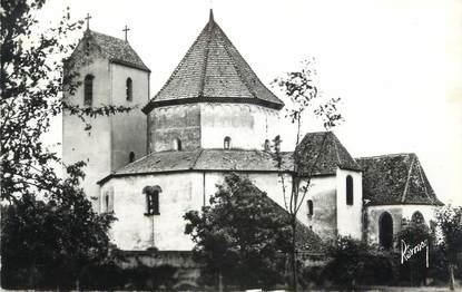 """CPSM FRANCE 68 """" Ottmarsheim, L'église et le monument aux morts""""."""