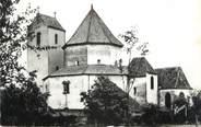 """68 Haut Rhin CPSM FRANCE 68 """" Ottmarsheim, L'église et le monument aux morts""""."""