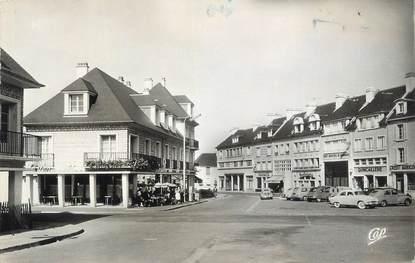 """CPSM FRANCE 14 """"Isigny sur Mer, La Place Général de Gaulle et le Versailles""""."""