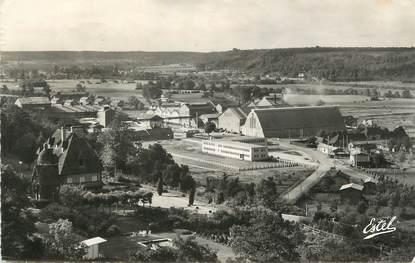 """CPSM FRANCE 27 """"La Rivière Thibouville, Panorama des usines Bouchon à Nassandres""""."""