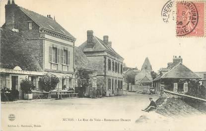 """CPA FRANCE 27 """"Muids, La rue de Voie, Restaurant Drieux""""."""