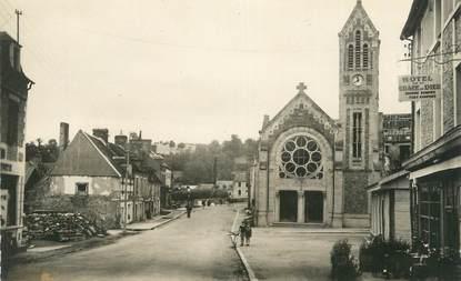 """CPSM FRANCE 14 """"Pont d'Ouilly, L'église et la rue principale""""."""