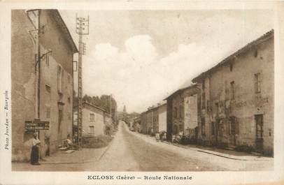 """CPA FRANCE 38 """" Eclose, Route Nationale""""."""