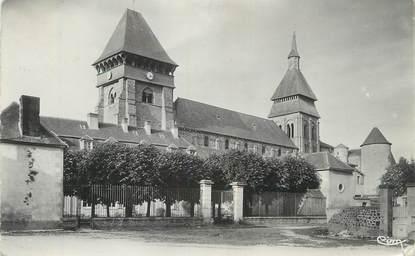 """CPSM FRANCE 23 """" Chambon sur Voueize, L'église et la Caisse d'Epargne""""."""