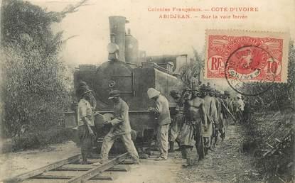 """CPA COTE D'IVOIRE """"Abidjan, sur la voie ferrée"""" / TRAIN"""