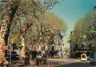 """CPSM FRANCE 83 """" Flayosc, Le centre ville""""."""