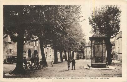 """CPA FRANCE 38 """" Crémieu, Place de la Nation, entrée de la Gendarmerie et ancienne fontaine"""""""