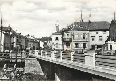 """CPSM FRANCE 88 """"Granges sur Vologne, Le pont sur la Vologne, la grande rue"""""""
