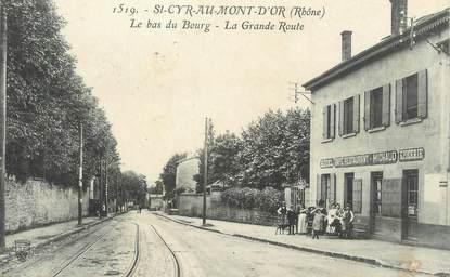 """CPA FRANCE 69 """" St Cyr au Mont d'Or, Le bas du bourg, La grande route"""""""